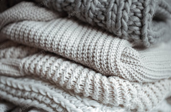 Close up of neatly folded knitted items close up.