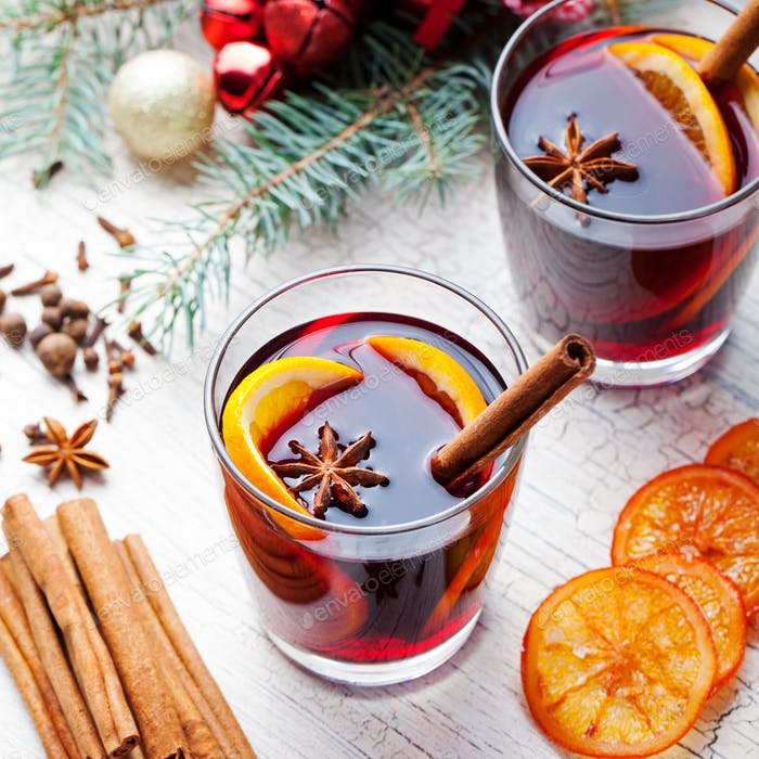 Mulled Red Wine with Spices, Orange Slices. New Year and Christmas Background.