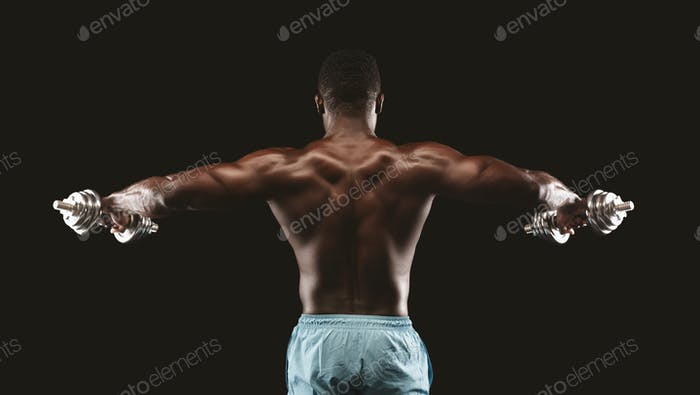 African american bodybuilder lifting hands with dumbbells up