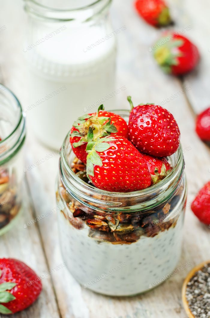 Chia seeds granola Greek yoghurt pudding with strawberries