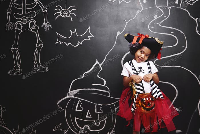 Cute girl in pirate costume in halloween