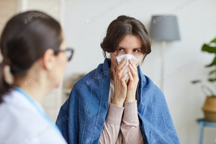 Sick woman visiting doctor