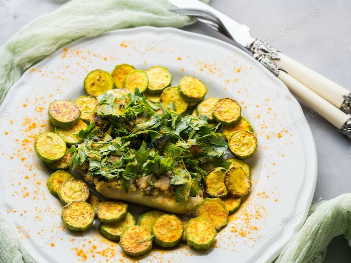 Stock fish fillet with turmeric courgettes