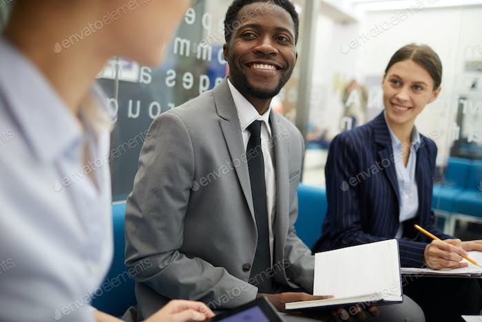 Smiling African Businessman in Meeting