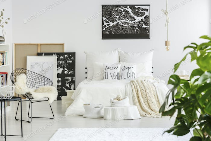 Map poster above bed