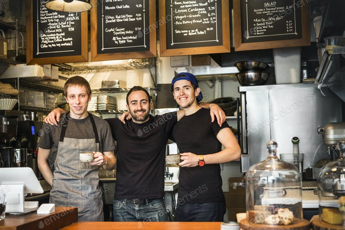 Portrait of three young men in coffee shop