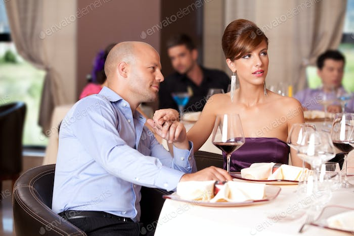 couple flirting at restaurant table