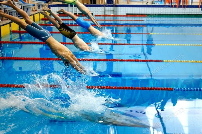 start group men athletes swimmers