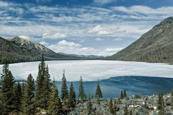 Multinskoe lake with snow. Altai mountains