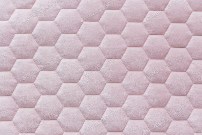 Pink color hexagon mesh fabric textured background
