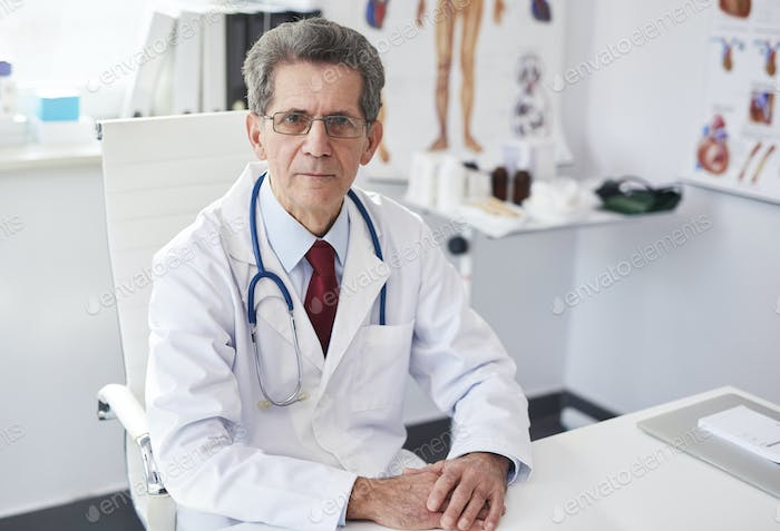 Portrait of senior male doctor in doctor's office