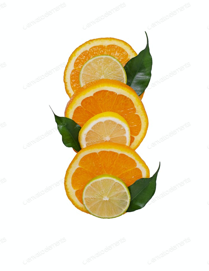 Different sliced citrus isolated on white