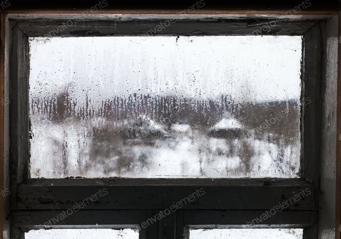 view of russian village through misted window