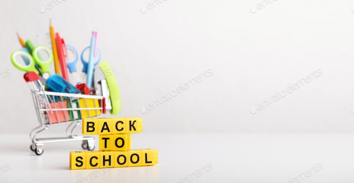 Shopping truck with office stationery on white background