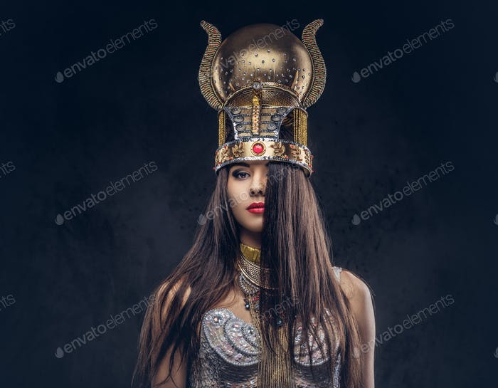Portrait of haughty Egyptian queen in an ancient pharaoh costume.