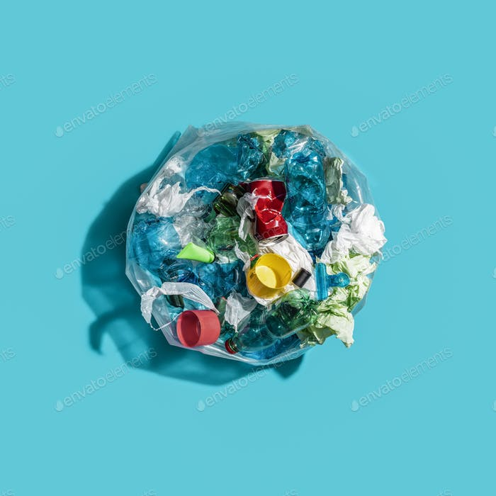 Garbage bag with plastic and mixed waste