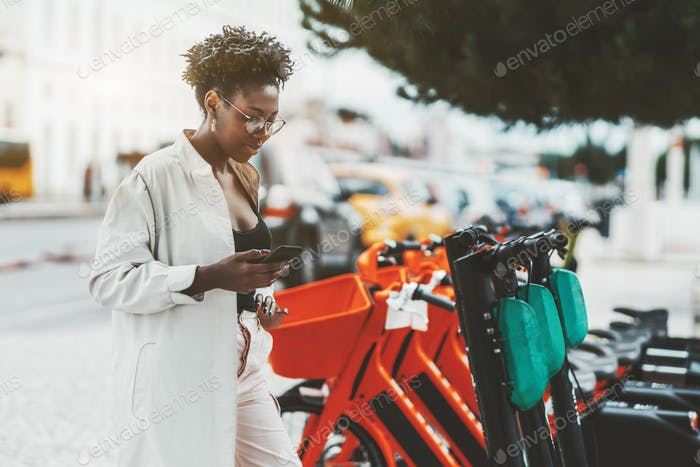Black girl activating an e-scooter