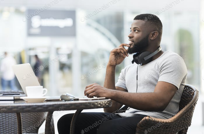Handsome african american guy looking away and thinking
