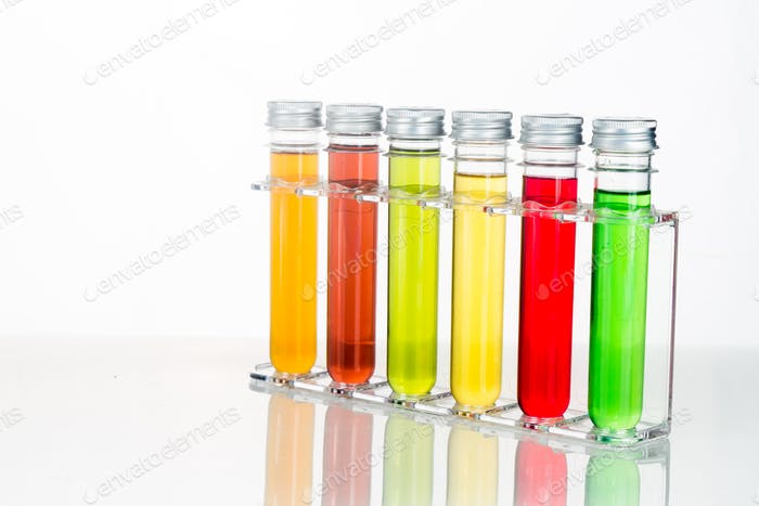 Test tubes with multi color chemicals isolated in white