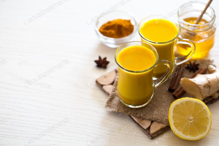 Turmeric tea drinks with milk and honey for beauty and health