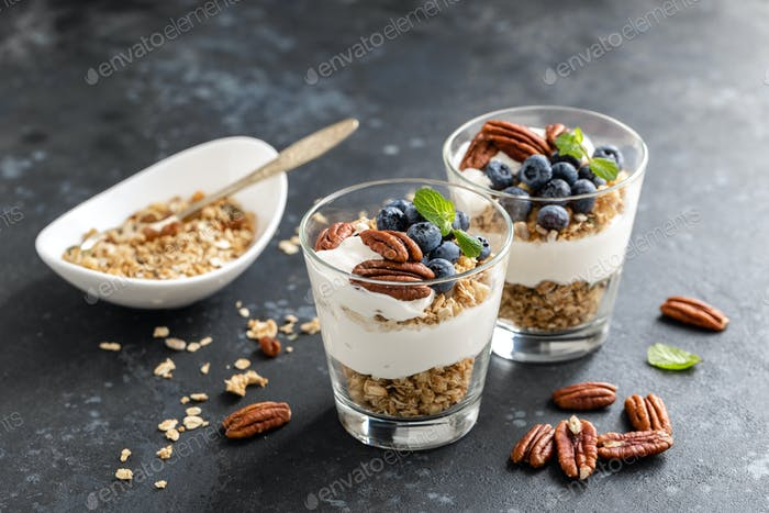 Blueberry parfait with ricotta cheese, granola and pecan nuts