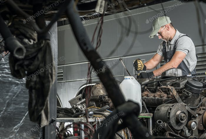 Automotive Technician Repairs Vehicle Diesel Engine