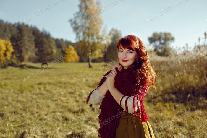 Beautiful girl outdoors in countryside