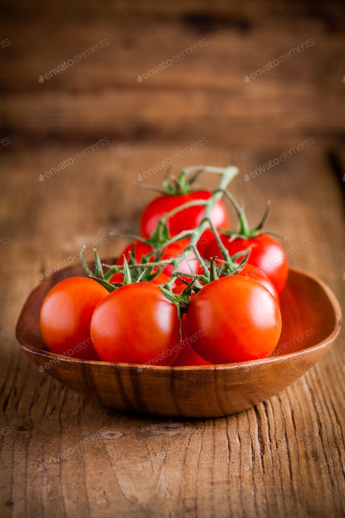a bunch fresh organic cherry tomatoes in a bowl