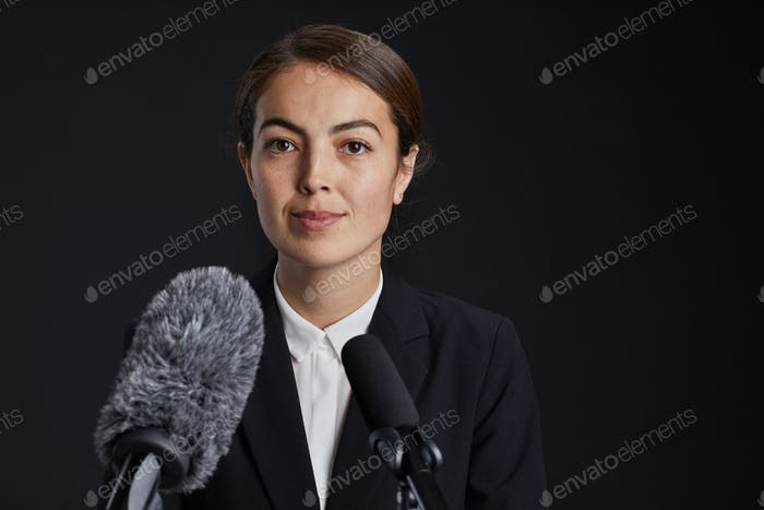Young Woman Speaking to Microphone