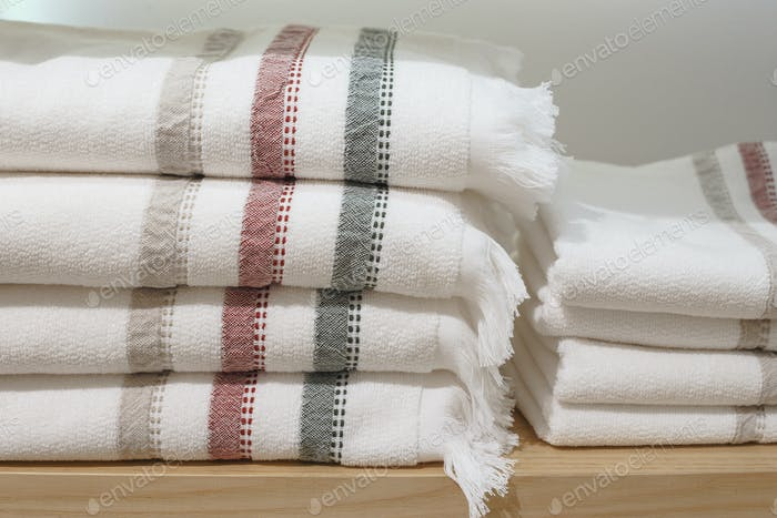 Shelves with towels stacks in shop. Hygge or another scandinavian style.