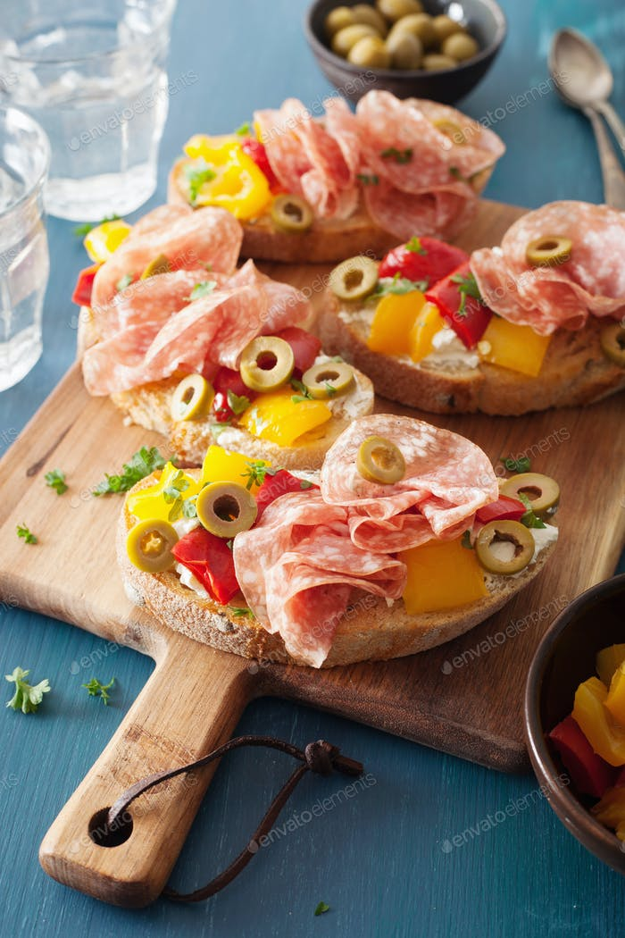 salami bruschetta with roasted peppers goat cheese olives