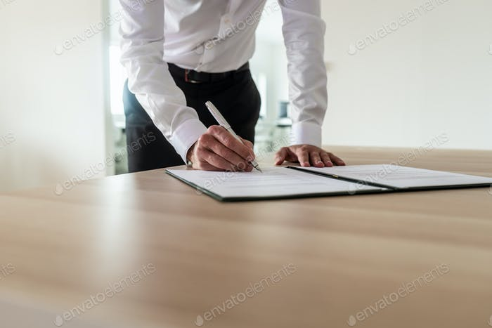 Entrepreneur signing document