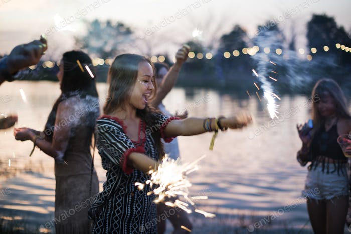 Woman Enjoying Sparkler in Festival Event