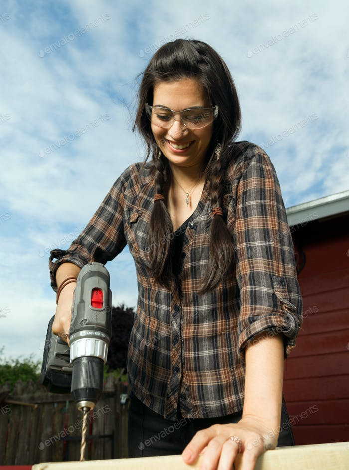 Craftsperson Woman Uses Power Screwdriver Drilling Wood Project