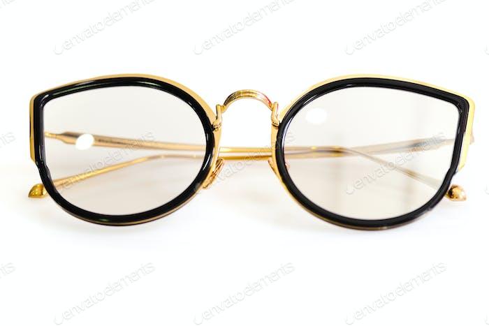 Female fashion glasses on white background