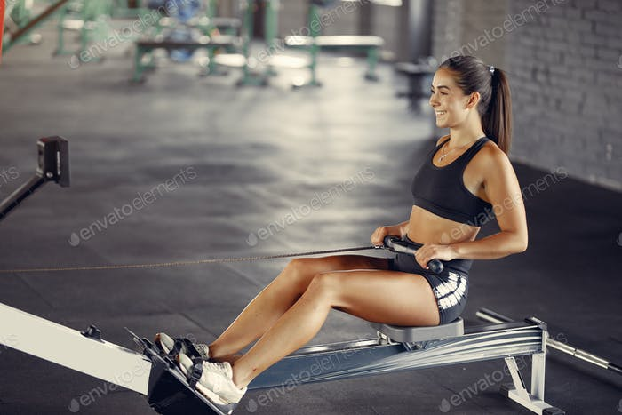Sports brunette in a sportswear training in a gym
