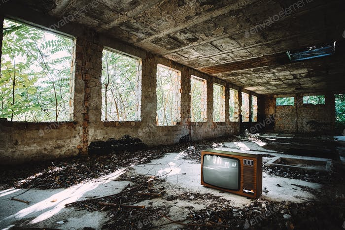 Old television in abandoned building