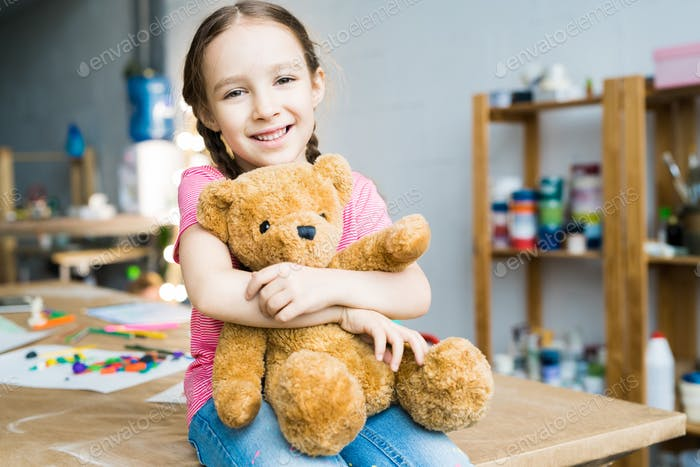Cute Little Girl with Teddy Bear