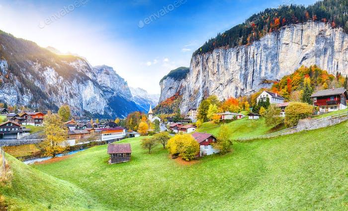 Amazing autumn landscape of touristic alpine village Lauterbrunnen