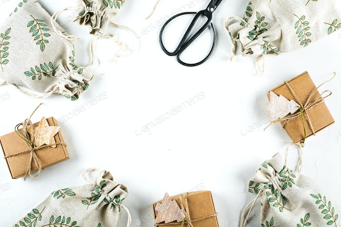Christmas Gift Flat lay. Zero Waste Gift Wrapping Holiday Season. Craft Boxes and Pouches