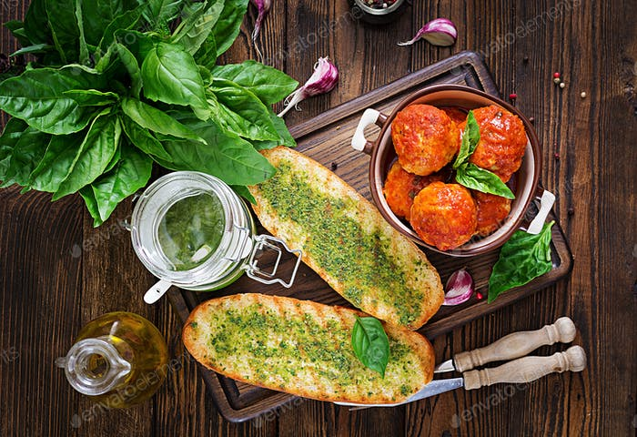 Meatballs in tomato sauce and toast with basil pesto. Dinner. Tasty food. Top view. Flat lay