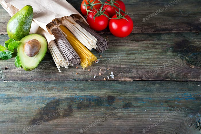 bunch of Italian spaghetti, noodles soba and sommel,  avocado with tomato