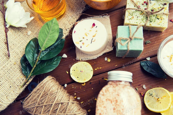 close up of body care cosmetic products on wood