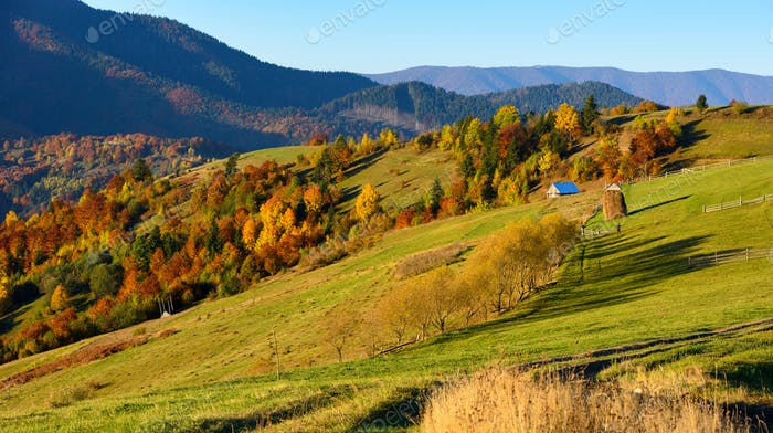 Beautiful autumn mountain landscape in the morning light with br