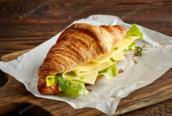 Croissant sandwich with cheese and salad