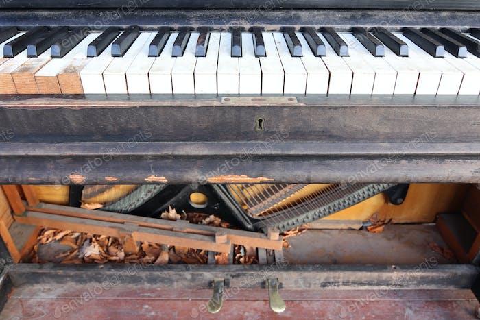 Old, broken, abandoned piano
