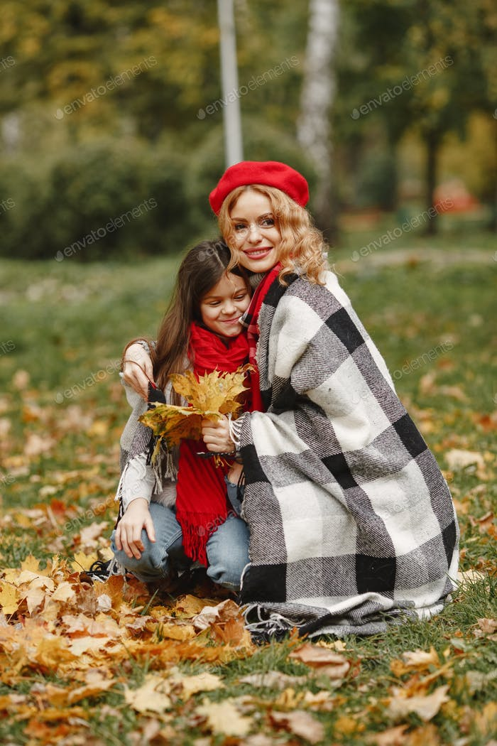 Cute and stylish family in a autumn park