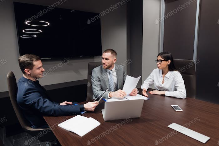 Startup business, creative business people of different age and races gather in meeting room in dark