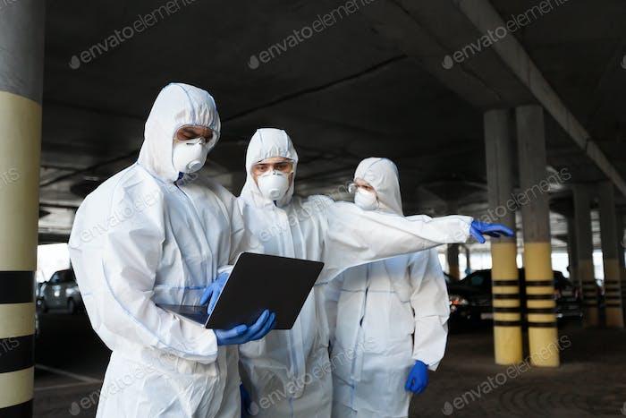 Virologists measuring level of coronavirus bacteria on streets
