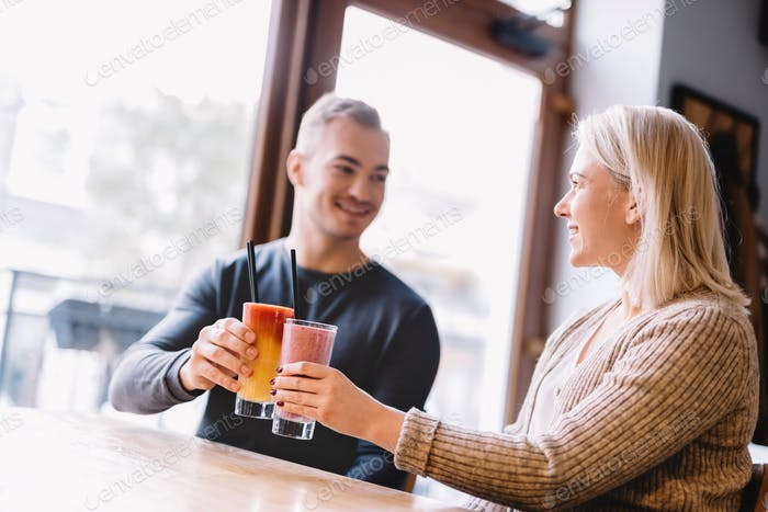 Young couple with a drink spending time together.